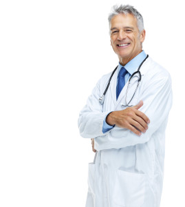 Portrait of smiling senior male doctor with hands folded on white background